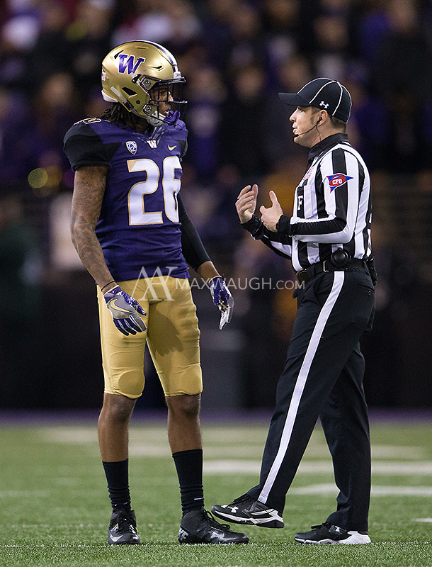 Sidney Jones discusses the rule book with an official.