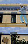 Mural on side of building with man escaping down side of building San Diego California