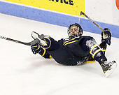 Clendening had his stick blade stuck in Jesse Todd's (Merrimack - 16) skate. - The visiting Merrimack College Warriors tied the Boston University Terriers 1-1 on Friday, November 12, 2010, at Agganis Arena in Boston, Massachusetts.