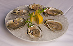 Washington DC; USA:  DC Coast, a fine dining restaurant.  Dish of iced blue point oysters.  .Photo copyright Lee Foster Photo # 24-washdc83039