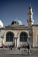 Young Eritreans play football behind the Great Mosque (Kulafuh Al Rashidin) in the center of Asmara, Eritrea..