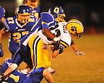 Oxford High's Juan Edwards (20) makes a tackle vs. Hernando in Oxford, Miss. on Friday, October 14, 2011. Hernando won 31-30 in overtime.