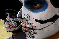 People is seen painted at Autonomous University of Mexico while they  celebrate the day of the dead in honor  to the 50 anniversary of the death of the Spanish-Mexican surrealist painter Remedios Varo, October 25, 2013. Photo by Miguel Angel Pantaleon/VIEWpress