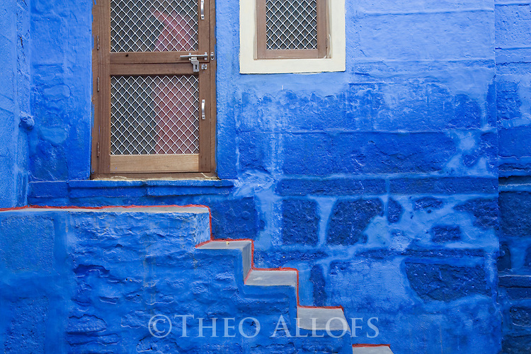 House front in Blue City (old town); the blue houses were originally for Brahmins but non-Brahmins soon joined in, as the colour was said to deflect the heat and keep mosquitoes away, Jodphur, Rajasthan, India