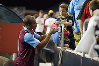 Gabriel Agbonlahor of Aston Villa signs a fans cleat during a match between Aston Villa FC and Philadelphia Union at PPL Park in Chester, Pennsylvania, USA on Wednesday July 18, 2012. (photo - Mat Boyle)