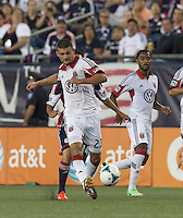 D.C. United midfielder Perry Kitchen (23) passes the ball.  In a Major League Soccer (MLS) match, the New England Revolution (blue) tied D.C. United (white), 0-0, at Gillette Stadium on June 8, 2013.
