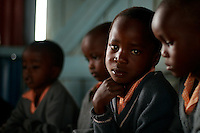 Emilio Koome works on an art project during class at the Pepo La Tumaini Early Childhood Development School in Isiolo, Kenya, on