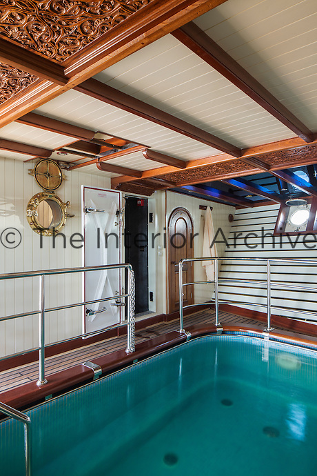 The swimming pool has been built at sea level and is filled with fresh water which is emptied into a special ballast tank when the yacht is underway