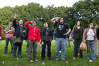 "16 October 2005 - New York City, NY - People stand to attention and salute as instructed by the file playing on their handheld digital music players in Central Park, New York City, USA, 16 October 2005, during a so-called ""MP3 Experiment"" organized by Improv Everywhere, a group of young artists which seek to organize bizarre, anonymous happenings and pranks."