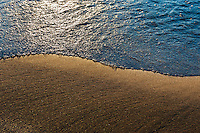 Lake Michigan gently caressing the sandy shores of the coastline in Holland, MI.