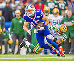14 December 2014: Buffalo Bills wide receiver Chris Hogan is tackled by Green Bay Packers inside linebacker Brad Jones after a 6-yard gain on a curl play reception in the second quarter at Ralph Wilson Stadium in Orchard Park, NY. The Bills defeated the Packers 21-13, snapping the Packers' 5-game winning streak and keeping the Bills' 2014 playoff hopes alive. Mandatory Credit: Ed Wolfstein Photo *** RAW (NEF) Image File Available ***