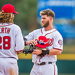 13 March 2016: Washington Nationals outfielder Bryce Harper receives his fielding gear from Jayson Werth during a pre-season Spring Training game against the St. Louis Cardinals at Space Coast Stadium in Viera, Florida. The teams played to a 4-4 draw in Grapefruit League play. Mandatory Credit: Ed Wolfstein Photo *** RAW (NEF) Image File Available ***