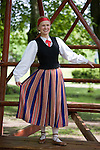 Young Smiling Woman in Estonian National Costume