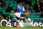 Celtic v St Johnstone...30.10.12      Scottish Communities Cup.Gregory Tade is tackled by Kelvin Wilson.Picture by Graeme Hart..Copyright Perthshire Picture Agency.Tel: 01738 623350  Mobile: 07990 59443