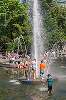 New Yorkers and visitors dip into the Washington Square Park fountain in Greenwich Village in New York on Saturday, July 11, 2015, 2015. Temperatures are expected to be in the high 80's F with low humidity but Sunday the temps rise and so does the humidity.  ( © Richard B. Levine)