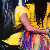 Colombian girls, wearing the national football team t-shirt, embrace themselves while watching the football match between Colombia and Uruguay at the FIFA World Cup 2014, in a park in Cali, Colombia, 28 June 2014.