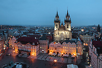 Evening view of Old Town Square or Staromestske namesti with the Jan Hus Memorial by Ladislav Saloun, 1915, and the Tyn Church or Church of Our Lady before Tyn, built 14th - 15th centuries in the late Gothic style, with multiple spires on each tower, Prague, Czech Republic. The historic centre of Prague was declared a UNESCO World Heritage Site in 1992. Picture by Manuel Cohen