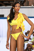 Model walks runway in a swimsuit from the Yard Rock - Candy Land 2013 collection, during the JRG Bikini Under The Bridge 2012 fashion show on July 9, 2012.