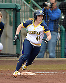 Michigan Wolverines infielder Caitlin Blanchard (44) rounds first during the season opener against the Florida Gators on February 8, 2014 at the USF Softball Stadium in Tampa, Florida.  Florida defeated Michigan 9-4 in extra innings.  (Copyright Mike Janes Photography)