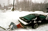 Salcha Area, near Midway, Alaska, U.S.A, January 1989. A sudden cold wave struck Alaska resulting to the temperature falling under 50 degrees Centigrade (58 degrees Fahrenheit). An instant car repair in T-shirt.
