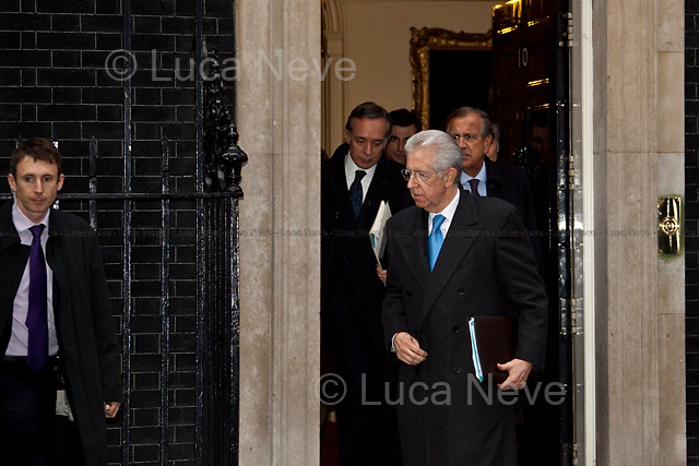Mario Monti (Italian Prime Minister).<br /> <br /> London, 18/01/2012. Mario Monti had his first institutional visit of the UK today, as the new Italian Prime Minister. &quot;Il Professore&quot; arrived at Downing Street at 13:00, where his host David Cameron was waiting, along with a number of prominent Italian and British members of the press. However a series of protocol mishaps ensued. After a friendly first handshake as Mario Monti leaves his car, the British and Italian Prime Ministers take their position at the door of No.10 for the press photo opportunity. It becomes apparent that no aide has been arranged by Downing Street to take Monti's coat, leaving the Italian Prime Minister fidgeting for an embarrassing while, as Cameron remains frozen, holding out an awkward un-met hand. Later, the famous &quot;UK First Cat&quot; was spotted, waiting outside his house for staff to open the door. Around 14:30, the meeting was seen to end as unconventionally as it had started: Mario Monti walked out of the door of the residence of the British Prime Minister with some of his staff, but without assistance or public send-off by Cameron.