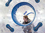 Morgan Adams, 16, of Canal Winchester, Ohio, races her sister in an inflatable human hamster ball at the Sibs Bash in Walter Fieldhouse on February 6, 2016. Photo by Emily Matthews