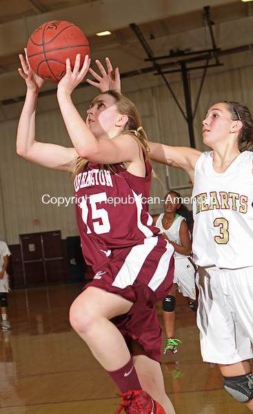 WATERBURY, CT-25 January 012514MK16 Torrington's Caroline Teti (15) goes up for a lay up as Sacred Heart's Maryn Vaillancourt (3) during NVL girl's basketball action Saturday evening at Sacred Heart High School.  Sacred Heart defeated Torrington 50-42. Michael Kabelka / Republican-American