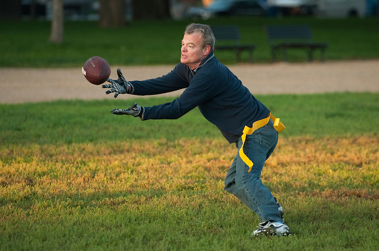 UNITED STATES - OCTOBER 04:  Rep. Mike McIntyre, D-N.C., catches a pass during a congressional football practice on the Mall in preparation for the upcoming game between members of Congress and the Capitol Police.  (Photo By Tom Williams/Roll Call)
