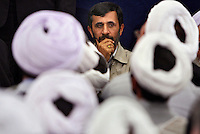 Iranian President Mahmoud Ahmadinejad holds his chin in his hand looking thoughtful during a meeting with religious figures in Tehran. One of the principal parts of his provincial visits are gatherings with the local clergy, who are highly supportive, but also fiercely critical of the leader. .. .