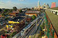 Skyline photography of the Charlotte NC downtown skyline. Photo, taken from the historic South End of Charlotte, is part on a regularly updated collection of Charlotte skyline imagery. The image shows the Charlotte LYNX Light Rail system, Charlotte Light Rail Blue Line, the Duke Energy headquarters tower (far left) and the Bank of America tower (center) as well as other key structures in the Charlotte NC skyline.<br /> <br /> Charlotte Photographer - PatrickSchneiderPhoto.com