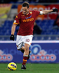 Calcio, Serie A: Roma vs Fiorentina. Roma, stadio Olimpico, 8 dicembre 2012..AS Roma forward Francesco Totti kicks to score his second goal during the Italian Serie A football match between AS Roma and Fiorentina at Rome's Olympic stadium, 8 december 2012..UPDATE IMAGES PRESS/Isabella Bonotto