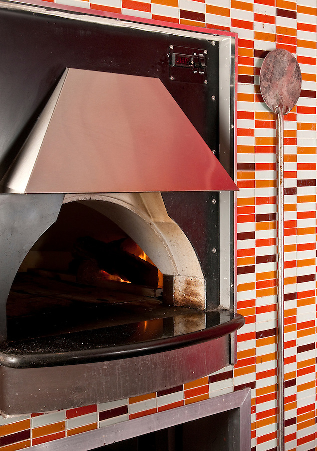 View of commercial oven in a pizza parlor kitchen.