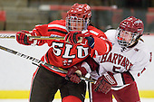 Kayla Sullivan (St. Lawrence - 13), Kelsey Romatoski (Harvard - 5) - The Harvard University Crimson defeated the St. Lawrence University Saints 8-3 (EN) to win their ECAC Quarterfinals on Saturday, February 26, 2011, at Bright Hockey Center in Cambridge, Massachusetts.