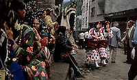 Cepne Women in Polka Dots in Marketplace.The severe geography of these mountains helps to retain culture. Girls in this village vote every year as to whether they will continue to wear these ancient outfits that date back to the Genoese traders. On the other side of the mountains, clothing is completely homogenous. .