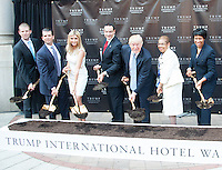 WASHINGTON, DC - JULY 23: (L to R) Eric Trump, Donald Trump Jr., Ivanka Trump, D.C. Mayor Vincent Gray, Donald Trump,  Rep. Eleanor Holmes Norton and DC Councilwoman Muriel Bowser at groundbreaking ceremony for the Trump International Hotel on July 23, 2014 in Washington, D.C. Photo Credit: RTNMelvin/MediaPunch