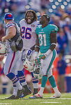 14 September 2014: Buffalo Bills running back Anthony Dixon smiles with Miami Dolphins safety Michael Thomas after the game at Ralph Wilson Stadium in Orchard Park, NY. The Bills defeated the Dolphins 29-10 to win their home opener and start the season with a 2-0 record. Mandatory Credit: Ed Wolfstein Photo *** RAW (NEF) Image File Available ***