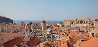 View over the rooftops of the medieval walled city with the Bell Tower, Cathedral and St Blaise Church and St Ignatius Church on the right, Dubrovnik, Croatia. The city developed as an important port in the 15th and 16th centuries and has had a multicultural history, allied to the Romans, Ostrogoths, Byzantines, Ancona, Hungary and the Ottomans. In 1979 the city was listed as a UNESCO World Heritage Site. Picture by Manuel Cohen