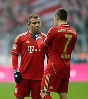 FUSSBALL   1. BUNDESLIGA  SAISON 2012/2013   21. Spieltag  FC Bayern Muenchen - SV Werder Bremen    23.02.2013 Franck Ribery (re, FC Bayern Muenchen) und Xherdan Shaqiri (FC Bayern Muenchen) im Gespraech