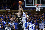 30 November 2014: Duke's Jahlil Okafor (15) blocks a shot by Army's Larry Toomey (33). The Duke University Blue Devils hosted the West Point Military Academy Army Black Knights at Cameron Indoor Stadium in Durham, North Carolina in a 2014-16 NCAA Men's Basketball Division I game. Duke won the game 93-73.