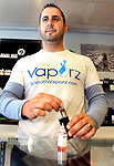 WATERBURY CT. 24 April 2017-042417SV03-Nick Ricciardi, owner, fills an e-cigarette vapor at Smooth Vaporz in Waterbury Monday. S.M.A.R.T., a parent group based in Southbury and Middlebury, is concerned over the growing popularity of vaping among youths. They say manufacturers try to lure teens into the addictive habit with flavors like Strawberry Quick. Proponents tout it as a healthier alternative to tobacco and say it helps smokers quit.<br /> Steven Valenti Republican-American