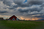 Idaho, North, Kootenai County, Post Falls. Unsettled evening skies on the Rathdrum Prairie in spring.