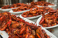 NWA Democrat-Gazette/ANTHONY REYES &bull; @NWATONYR<br /> Plattered crawfish waiting to be taken out to the tables Wednesday, April 15, 2015 at The Hive, inside the 21C hotel, crawfish boil block party in Bentonville. Many boils happen this time of year. The Hive's boil featured a four course meal with crawfish flown in fresh from the gulf coast. Chef Matt McClure created each dish.