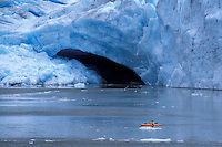 Kayaking in front of Bear Glacier, near Stewart, British Columbia, Canada