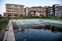 The former Grand Hotel's Olympic-size swimming pool now used for laundry and a rubbish dump. Once a luxury destination for the wealthy and the continent's biggest hotel, the building is now a concrete shell and home to about 6,000 squatters. Those unable to occupy one of the rooms sleep in the corridors, basements and even on the roof of the building.
