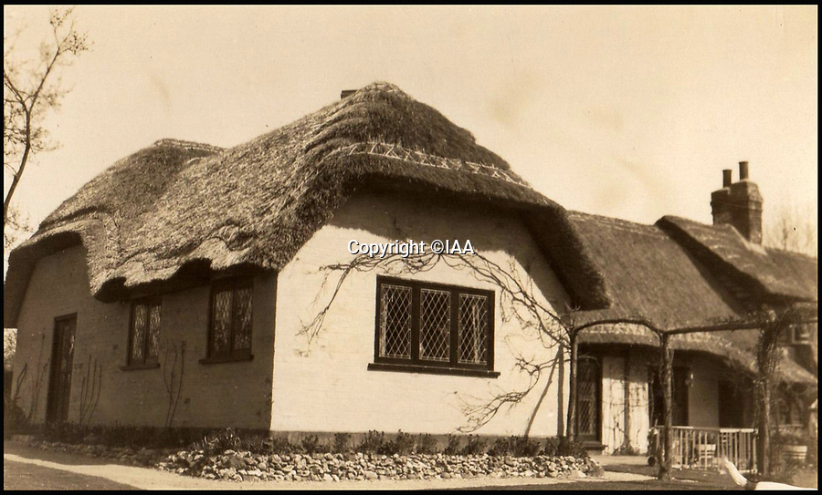 BNPS.co.uk (01202 558833)<br /> Pic: IAA/BNPS<br /> <br /> Enid Blyton's home, Old Thatch.<br /> <br /> Enchanting photographs of children's author Enid Blyton with the pet dog that inspired many of her early works have come to light.<br /> <br /> The black and white photos depict Bobs, Blyton's fox terrier who became a celebrity in his own right after she started writing letters from him in the magazine Teacher's World in 1933.<br /> <br /> The signed letter and the picture postcards were sold by International Autograph Auctions of Nottingham for &pound;200.