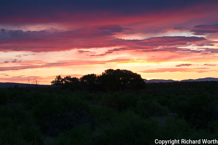 In a matter of moments the sky goes from orange to red as the sun sets in the Great Basin Desert near Fallon, Nevada.