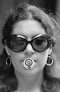 August 1970, Manhattan, New York City, New York State, USA --- Lawyer and member of the National Organization for Women Karen DeCrow holding a NOW pin in her mouth during a protest against the McSorley Old Ale House in Manhattan in 1970. The bar had refused to serve women until 1970. --- Image by © JP Laffont/Sygma/CORBIS