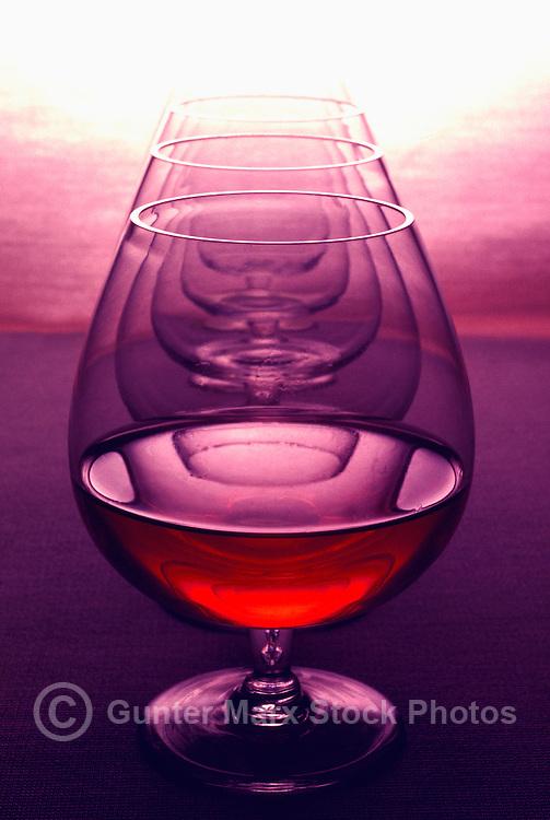 Row of Brandy Glasses, One Glass Half Empty / Half Full