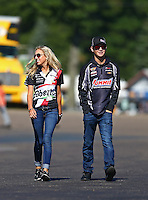 Aug 21, 2016; Brainerd, MN, USA; Johnna Dunn (left) granddaughter of NHRA funny car team owner Jim Dunn and Cody Anderson , son of pro stock driver Greg Anderson during the Lucas Oil Nationals at Brainerd International Raceway. Mandatory Credit: Mark J. Rebilas-USA TODAY Sports