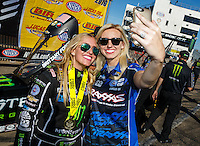 Aug 21, 2016; Brainerd, MN, USA; NHRA top fuel driver Brittany Force (left) poses for a selfie with sister Courtney Force as they celebrate after winning the Lucas Oil Nationals at Brainerd International Raceway. Mandatory Credit: Mark J. Rebilas-USA TODAY Sports